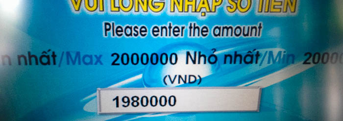 Withdrawing 1,980,000 VND from an ATM