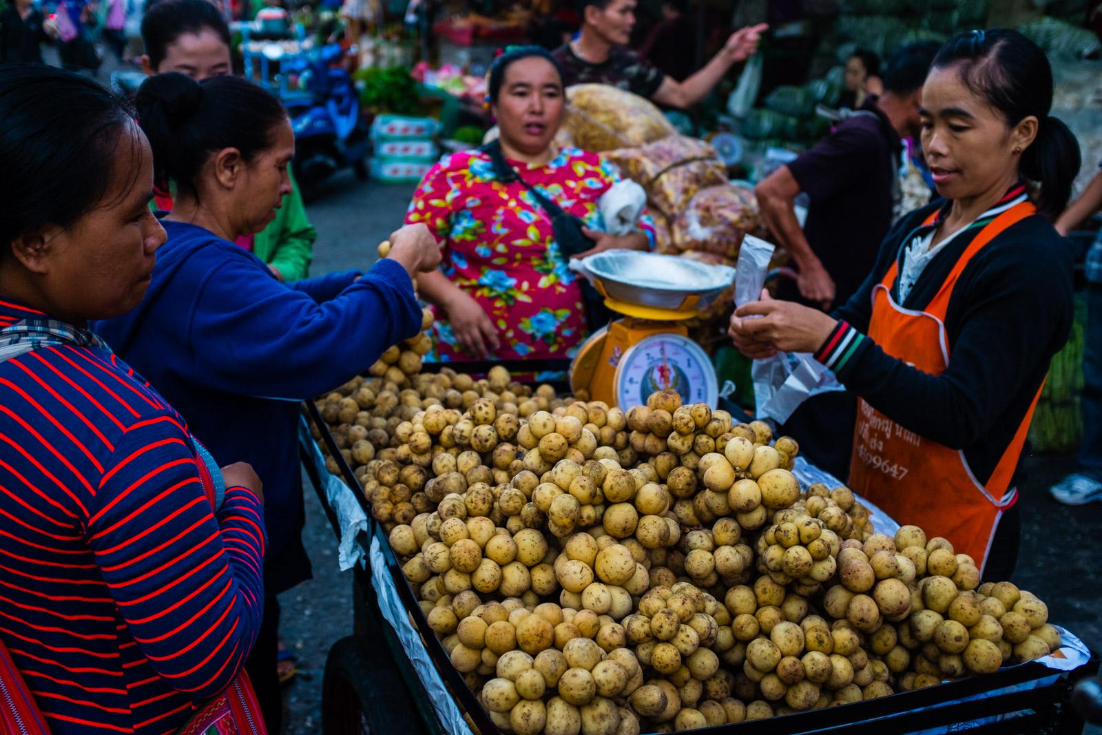 Women buying fruit